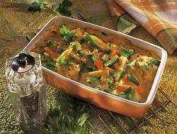 Vegetable casserole with cheese sauce baked