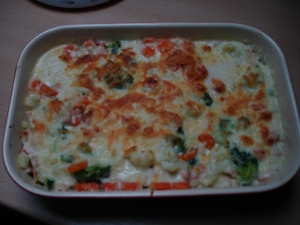 Vegetable casserole with cheese sauce