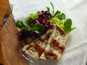 Chickenmushroom strudel in plum dressing on salads