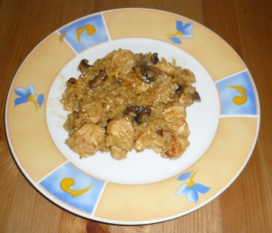 Colorful rice dish with turkey and mushrooms