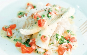 Game fish fillet with tomato and basil