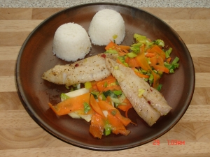 Pangasius fillet with vegetables on rice balls