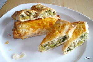 Puff pastry filled with spinach olives rice cheese and ground beef