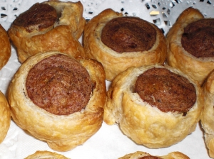 Sausage wrapped in puff pastry finger food