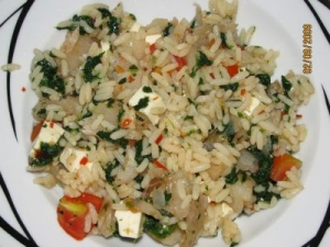 Sweet and spicy rice salad with salmon feta tomato and spinach