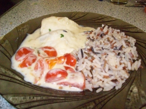 Tilapia with lemon basil sauce and date tomatoes at three colored rice