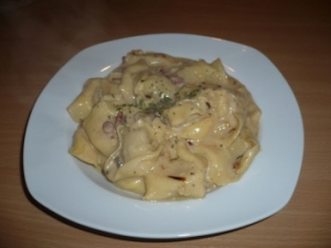 Tortellini with bacon and cheese sauce