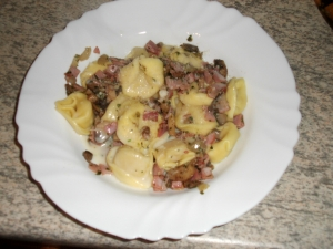 Tortellini with ham in cream sauce
