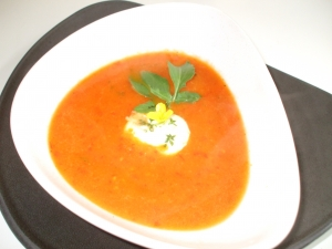 Spicy tomato and pepper soup with garnish