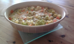 Bulgur and vegetable casserole with goat cheese cream and parmesan crust