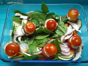 Entree salad with stuffed tomatoes