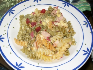 Fast colorful pasta dish with sausage and egg
