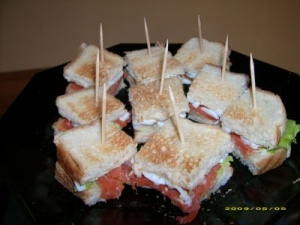Sandwich topped with salmon egg horseradish and salad
