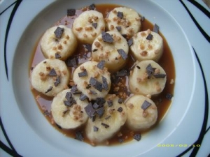 Banana With Caramel Sauce With Grated Chocolate And Praline
