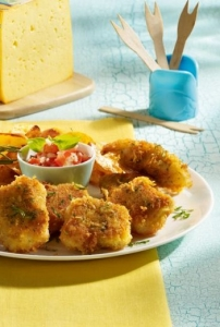 Chicken nuggets with potato wedges and Ksepanade with tomato salsa
