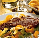 Pork with apricot and leek vegetables