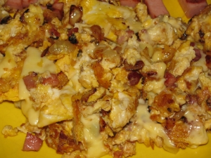 Spicy Scrambled Eggs With Bacon Onion And Cheese
