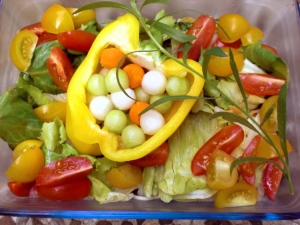 Bell pepper salad filled with colorful beads on green salads
